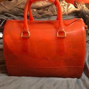 Really cute FURLA orange jelly tote.